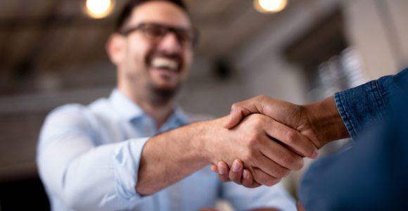 A handshake between happy colleagues.